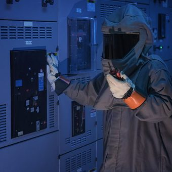 person in arc flash suit