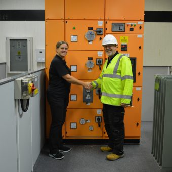 man and woman shaking hands switchroom